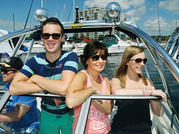 Jay QuoVadis, from left, piloting the family boat, is joined by son Brandon, his wife Suzy and Coral Tankard on Kempenfelt Bay.