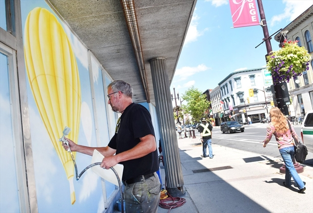 Artist brightens dilapidated downtown building