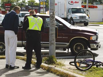 Pickup truck vs. cyclist