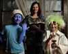 Kate Leighton (centre) holds a Bible as her children Malinda (left) and Nicholas model their Halloween costumes.