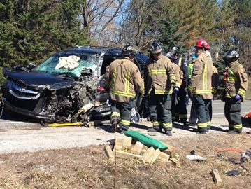 Car and school bus collide in Milton