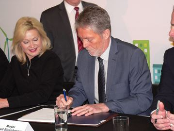 Hamilton Mayor Fred Eisenberger signs utility merger documents