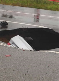 Sinkhole car driver suing city for more than $500,000– Image 1