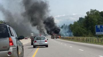 A car engulfed in flames on the 401 near Joyceville Road