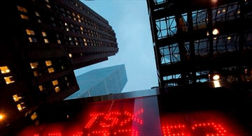 A TSX tote board is pictured in Toronto, on Dec. 31, 2012. The Toronto Stock Exchange's S&P/TSX composite index was down 45.82 points to 15,196.06, after 90 minutes of trading.THE CANADIAN PRESS/Frank Gunn