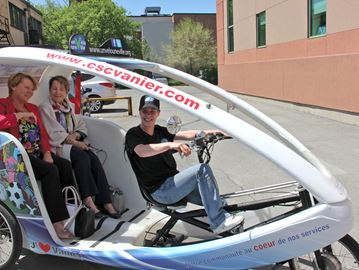 Tricycle taxi for seniors coming to Vanier