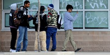 Staff and students at Harold M. Brathwaite and Louise Arbour secondary schools arrived at their school to find gang-style graffiti had been sprayed on the walls and windows overnight.