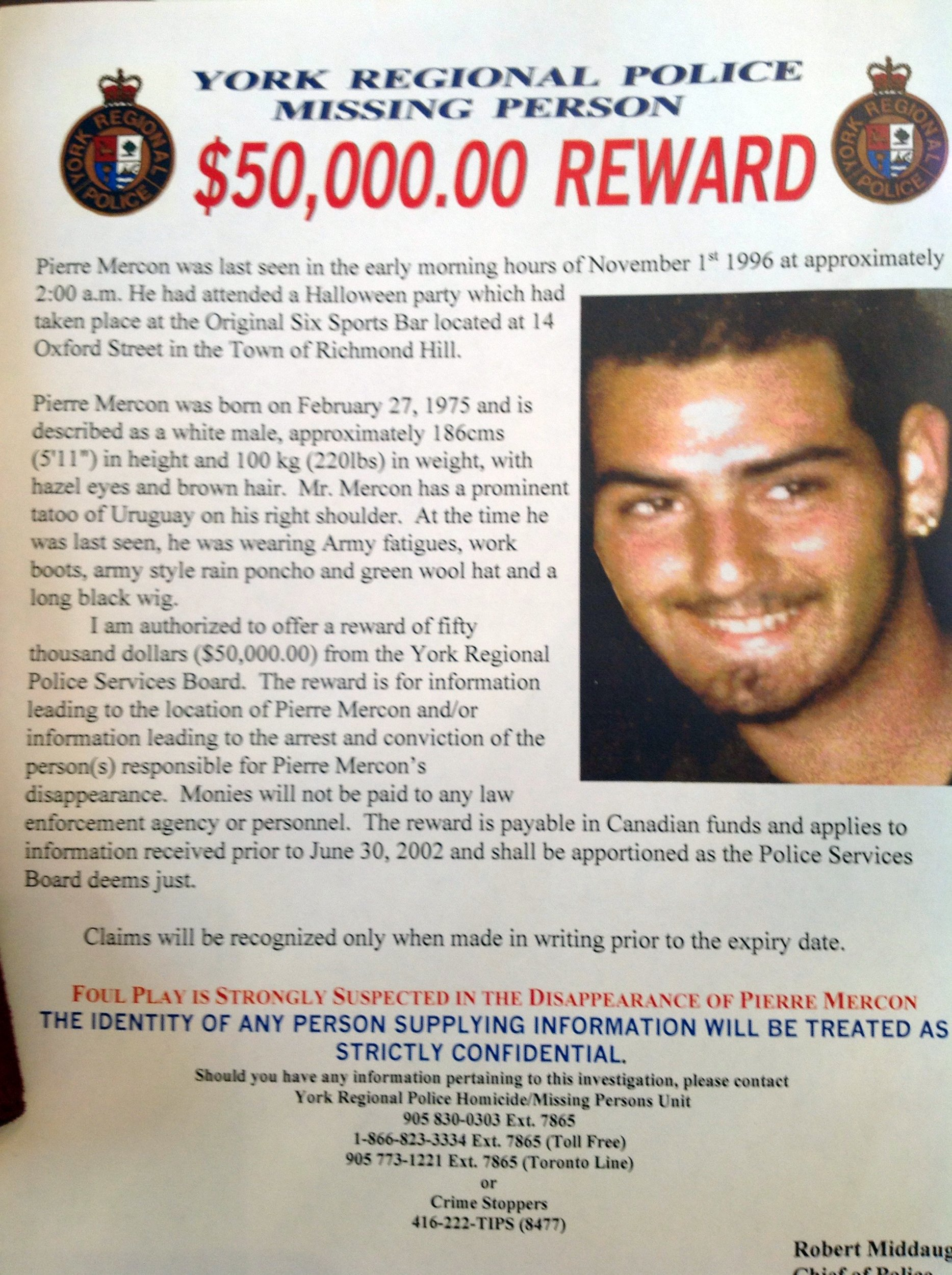 A missing person poster offering a $50,000 reward of information on the whereabouts of Pierre Mercon