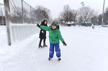 Batsang Tenzim Rangdel (foreground) and friend Tenzin Youtso test out their balance at the rink in Dufferin Grove Park during the annual Wonderful Winter Craft Fair and Skate on Sunday. (Dec. 15, 2013)