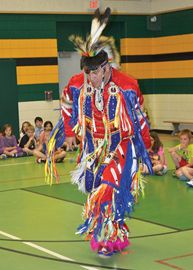 Lee Benson performs a traditional grass dance.