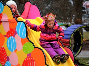 Paige Warburton, 4, takes a turn on a slide.