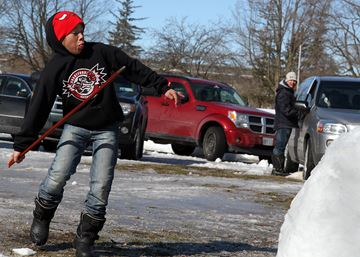 Travis Anderson hurls a snowsnake during the annual Snowsnake Tournament at the Woodland Cultural Centre on Saturday.
