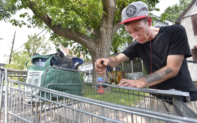 Scrapper Jack Edworthy ties to get a transformer out of a former stove to sell for copper to subsidize his social assistance.