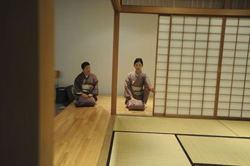 Student Takako Yoshimoto learns the correct way to open the door from instructor Sumiko Yamashita during a Japanese Tea Ceremony class Friday at the Japanese Canadian Cultural Centre.