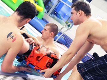 Volunteer firefighters practice water rescue