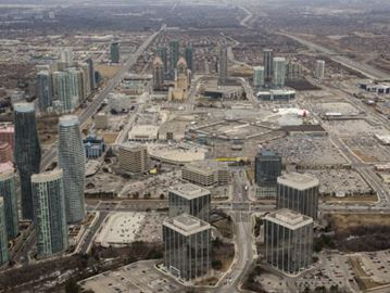 An aerial shot of Mississauga Square One shows the build-up of the city over the three decades under the guidance of Mayor Hazel MacCallion.