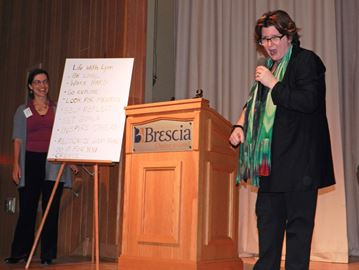 Chef Lynn Crawford holds an impromptu charity auction for the cliff notes version of her speech The Circle director Tracy Robinson took down at Brescia University College Thursday (March 6).