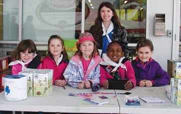 Selling Girl Guide Cookies on Girl Guide Cookie Day in Richmond last Saturday at King's Your Independent Grocer in Richmond are, front row, from left, Nathalie Spittle, Lauren MacDonald, Chloe Kasavage, Janae Lewis and Alyssa Hogle, and, standing behind them, Pathfinder Juliet Maniloff.