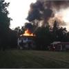 Fire breaks thru roof