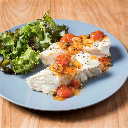 Roasted garlic and cherry tomatoes enhance this easy fish dish