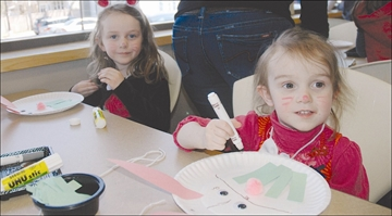 Addyson Lekx-Toniolo, 5, and her sister Taylor, 2,have been busy and have almost completed their craft bunnies at the North Grenville Library .