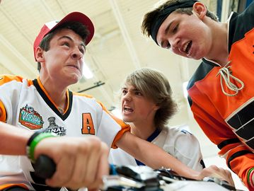Austin Georgas, grade 10 student of Garth Webb, pushes through his last 30 seconds on the bike while his teammates, Matt McFarlane, left, and Connor Renton, right, cheer him on. Hannah Yoon/Metroland Media Group