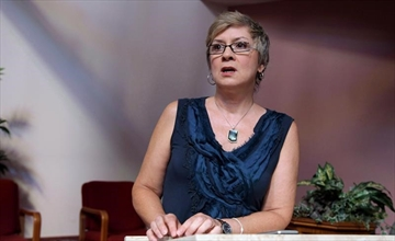Rev. Gretta Vosper is seen at her West Hill United Church in Toronto on Wednesday, Aug. 5, 2015. An unprecedented ecclesiastical court hearing that could see the United Church defrock a self-professed atheist minister who does not believe in the Bible has been postponed indefinitely. THE CANADIAN PRESS/Colin Perkel