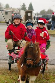 Tyler Lamour, Hailey Thompson, Olivia Lamour and Barney join the Harrowsmith Santa Claus parade on Saturday morning.