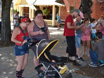 Pokémon Go fans take to the shade while searching for the creatures in Gravenhurst Saturday.