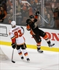 Ducks' top line roars past Flames 5-3, keeping streak alive-Image1